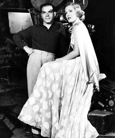 Jean Arthur and director Frank Capra on the set of You Can't Take It with You (1938).