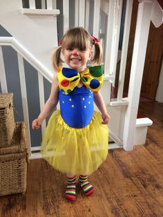 Home made Mr Tumble Something Special dress up for girls party - Tutu, leotard, yellow star stickers, bow tie, stripy socks, bow ties in hair, red nose and freckles. Under £20 for all elements of outfit