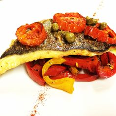 Pan seard Branzino with Roasted bell peppers tomatoes confit and capers