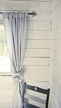 Grey linen curtain in a cottage interior