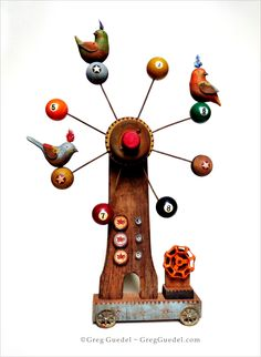 Fortune Wheel ~ folk art assemblage of carved wood birds, savlage wood and found objects by Greg Guedel.   www.gregguedel.com