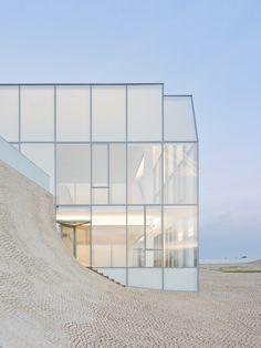 Beautiful glass structure, modern.  Would not want to clean the windows! Steven Holl.