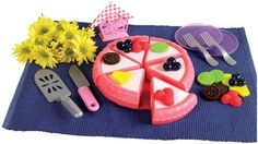 Living Pretend Play Create-A-Cake by Small WorldExpress. $14.24. From the Manufacturer                What can be more fun than adding your own delectable delights to this cake. Cake and toppings have hook and loop fasteners so decorating and cutting is a breeze. Thirty-one piece set includes 6 cake slices, cake dish, cake knife, spatula, 2 forks, 2 plates, napkin holder, 2 napkins, 3 clusters of raspberries, 3 clusters of blueberries, 3 pineapple slices, 3 kiwi slice...