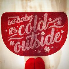 """This indoor welcome mat, christmas rug or carpet in red with the cursive text 'Baby it's Cold Outside' is the perfect winter themed item to place at your doorstep. It's great for enhancing your Christmas or holiday home decor, as a winter housewarming gift or to surprise your family when you come home for the holidays. This red berber rug is 18"""" x 27""""    Don't miss out! THERE'S ONLY ONE LEFT so order before it's gone!     Ever need an excuse to make someone stay over night this winter? Just…"""