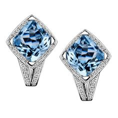 Fou de Toi earrings by Mauboussin. White gold, blue topaz and diamonds.
