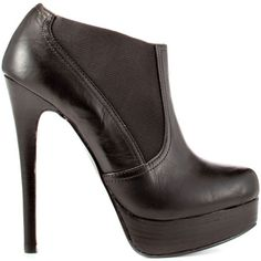 Lolaa - Black Vintage Leather by Chinese Laundry. I think these are great with skinny jeans. Its important to get a boot that isn't above the ankle. Skinny jeans look awful pulled over the ankle of a boot. Make sure your jeans come down over the boot. I think a good length is down to where the bottom of you heal sits in the shoe.