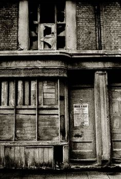 John Claridge - Boarded up shop in the East End, 1966. I wonder what this shop was. And the Mass X-Ray poster - TB was still around.