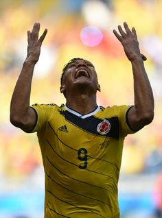 Colombia's forward Teofilo Gutierrez celebrates after scoring during a Group C football match between Colombia and Greece at the Mineirao Arena in Belo Horizonte during the 2014 FIFA World Cup on June (EITAN ABRAMOVICH/AFP/Getty Images ) Teofilo Gutierrez, Football Match, Fifa World Cup, Cool Photos, Around The Worlds, Celebrities, June, Group, Brazil