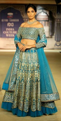A model displays an aqua blue designer wear at one of the FDCI ICW events. (Source: Rediff)