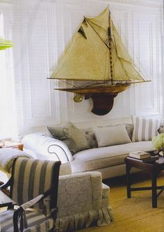 Magnificent model sailboat, too much white for my taste, but love the elements of the room