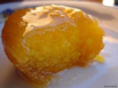 """Papo de Anjo: Portuguese for """"angel's double chin"""", this baked egg yolk pastry is also known as an """"angel's teat"""". Back in the 14th or 15th century, Portuguese convents and monasteries took in laundry.  The nuns and monks used egg whites for starching the clothes, so they ended up with a surplus of egg yolks. Not wanting these to go to waste, they whipped the yolks into a thick batter, and baked them into little cakes that were then boiled lightly in syrup."""