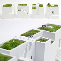 These micro landscape planters look like a row of tiny houses (Ienami = row of houses in Japanese) and have rooftop gardens for planting and growing small foliage like moss or succulents.