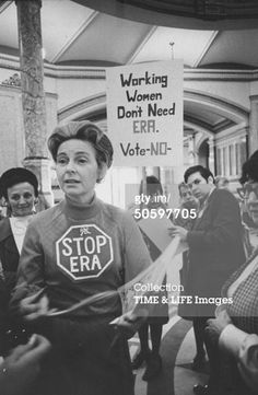 Opponent of ERA Phyllis Schlafly wearing a STOP ERA sign on her chest as she leads a group of protestors w. sign that reads WORKING WOMEN DON'T NEED ERA/VOTE NO in the halls of the IL state capitol as the legislature considers the amendment. (Photo by Michael Mauney//Time Life Pictures/Getty Images)