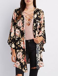 Soft woven fabric forms a breezy kimono that's sure to be a favorite layering piece! Bold floral print makes a statement look, while an open front drapes gracefully between wide, draped sleeves. Kimono Outfit, Kimono Fashion, Love Fashion, Autumn Fashion, Fashion Looks, Boho Outfits, Spring Outfits, Trendy Outfits, Cheap Boutique Clothing