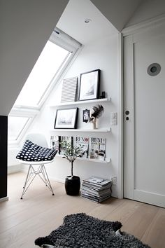 Nice bright place to sit and picture shelve make the most of the space and make the magazine covers work as art