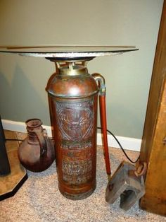 Make an end table with that old fire extinguisher you have stashed in the corner. This will be perfect for my deck.......D.