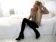 Sheer blouse with leggings and boots.