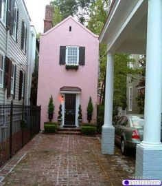 "My first thought when I saw this was ""that looks like it could be in Charleston!""  Well, it turns out it IS in Charleston.  It is on Tradd St., so now I am in hot pursuit to find it!"