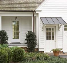 Gray metal awning over door (modern farmhouse). Farmhouse Exterior, House With Porch, Farmhouse Porch, Porch Design, Front Door, Farmhouse Garden, Garage Door Design, White Exterior Houses, Building A Porch