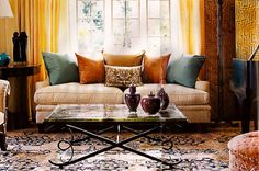 living room / persian rug / shades of yellow + orange + blue / eclectic / warm + inviting / mix of antiques and modern furniture