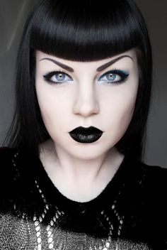 Black lips, full coverage foundation, liquid liner, and pop of bright eyeshadow.