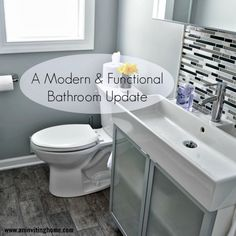 modern and functional bathroom update, An Inviting Home on Remodelaholic6 x 24 Porcelain Tile Floor – Timber Traditional (in gray) from Menards Toilet – Stratus HET Tall Height Elongated from Mendards Window – 24×42 Vinyl Single Hung from Menards Cabinet – Lillangen Sink Base from IKEA Sink – Lillangen Sink from IKEA Faucet – Dalskar Chrome Plated from IKEA Medicine Cabinet – Lillangen Mirror Cabinet from IKEA Hanging Shelf – Lillangen End Unit from IKEA Tile Back Splash – Malco Stria from…