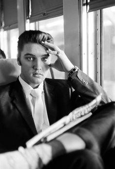 """Going Home"", Elvis On The Southern Railroad between Chattanooga and Memphis, Tenn., July 4, 1956.     © Alfred Wertheimer. All rights reserved."
