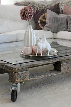 Love this decor so much, i.e. the pillows, sofa, tablescape and especially the recycled table on wheels. Biddy Craft