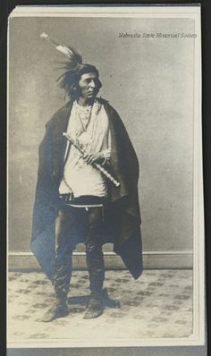 Full length, standing portrait of White Breast. He was a member of the delegation of Winnebago that went to Washington D.C. to negotiate for a permanent reservation. Date 1865