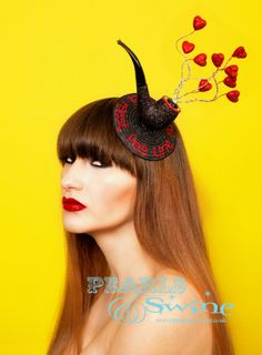 "Inspired by Rene Magritte's painting ""This Is Not A Pipe."" Surreal pipe #Valentine hearts fascinator by #PearlsAndSwine."