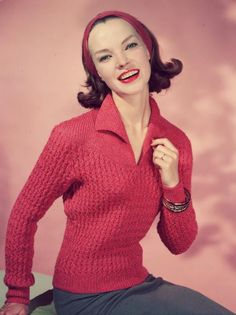 Pretty In Pink: A fifties fashion model wearing a knitted v-neck jumper and with her hair scraped back in a matching headband. (Photo by Chaloner Woods/Getty Images) #1950s