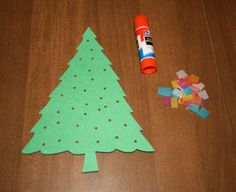 Punch holes in tree and have kids glue tissue paper on the back to make it look like lights.  Plus has a tree template to print!
