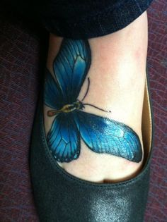 Blue butterfly foot tattoo - I love the vibrancy of the color.