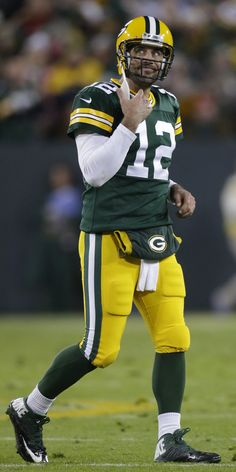 Green Bay Packers quarterback Aaron Rodgers walks off the field after wide receiver Jordy Nelson raced 73 yards for a touchdown. - Image credit: Mark Hoffman Packers 55, Bears 14 - JSOnline