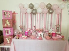 Pink baby shower table based on ideas from Pintrest
