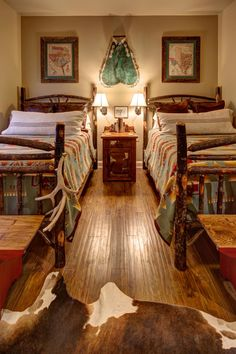 Rustic and Southwestern styles combine expertly in this lodge-style bedroom. A cowhide rug softens the hardwood floors, and pops of turquoise add brilliant color.
