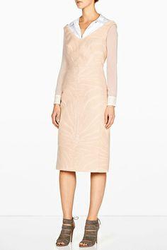 Modernize a dress with a wide neckline by wearing an unbuttoned shirt underneath.