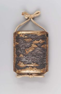 Four-case inro with wave and rocks design. Edo period. Late 17th–early 18th century. Goto Denjo.