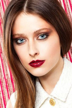 """The Best New Beauty Trends For Your Sign #refinery29  http://www.refinery29.com/makeup-2015-horoscope#slide-16  """"This look needed to be a full roar,"""" Noto says. """"So, I used a metallic, red-brown liner on the waterline and top lashes, and smoked it out with a small brush. Then, I took an eyeshadow in a similar color and buffed it out into the lid, creating an elongated cat-eye shape, [and added] a dark-gold shadow to the inner corner."""" As for the lips, a classic slick of crimson did the trick…"""