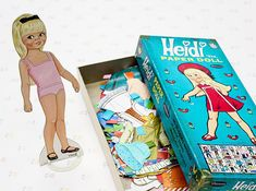 Vintage Heidi paper doll kit from 1967. In very good condition and comes with one heidi doll and a plastic stand, 41 articles of clothing and 12 accessories (53 total). See our photos where all the cut clothes and accessories can be seen in detail. Just a few of the items have minor