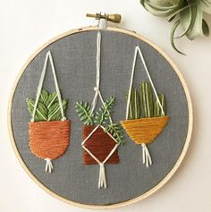 Three adorable plants, hanging out in baskets and macrame hangers, stitched on black or gray linen, set in a 5 wooden embroidery hoop. The colors are vivid and lush! **Please select your background at checkout, and if you want 3 specific plants let me know. (Sometimes I vary the order