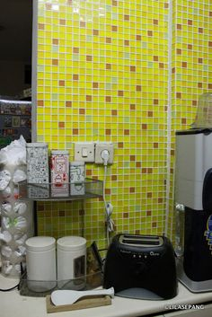 Lovely mixture of colours on yellow kitchen tiles