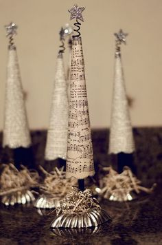Christmas Trees Made with Old Music Paper and Vintage Tart Tins and Glitter.