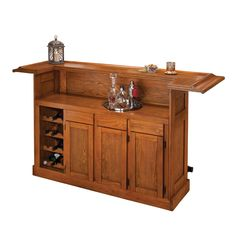 Create a comfortable bar space in your own home with this beautiful oak bar. Crafted with durable wood and veneers, this classic bar features a wine rack, plentiful storage and a stylish black footrest to create an enjoyable drinking experience.