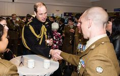 A smartly-dressed Prince William drank a glass of water as he chatted to medal winners and...