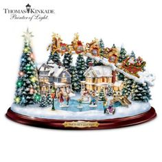 Musical Thomas Kinkade Christmas Sculpture Featuring Santa, Reindeer and Illuminated Holiday Village with Twirling Skaters!