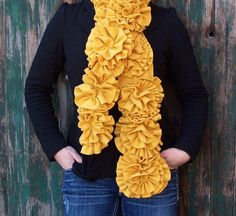 Flower scarf made with fleece rosettes. I bet it would be fairly simple to make. Wish I knew how!
