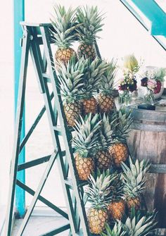Who doesn't need a pineapple ladder at their tropical reception! Interesting to incorporate height in with some of the basics. Would want to pop up the pineapples color-wise. ------------- Trending - 15 Must See Pineapple Wedding Ideas Tropical Bridal Showers, Tropical Party, Tropical Vibes, Surf Wedding, Hawaii Wedding, Tropical Wedding Reception, Wedding Favors, Wedding Decorations, Wedding Ideas