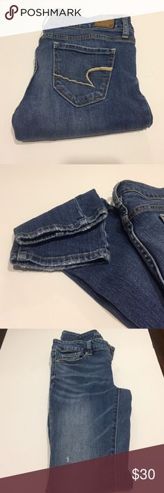 """American Eagle stretch jeans The most comfortable jeans ever!  American Eagle stretch skinny jeans. Size 4 Long. Has some minor wear on bottoms but no other flaws. Inseam 32"""" American Eagle Outfitters Jeans Skinny"""