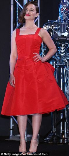 Lady in red: Clarke donned a crimson dress with matching lipstick, a pair of silver heels ...
